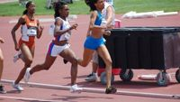 Chanelle Price, Easton, passing LaTavia Thomas, West Catholic, in the 800 Trials